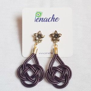 Metallic Purple leather tied into Double Coin knot design with Titanium post for metal sensitive ears. Hangs 2 1/4 inches in length