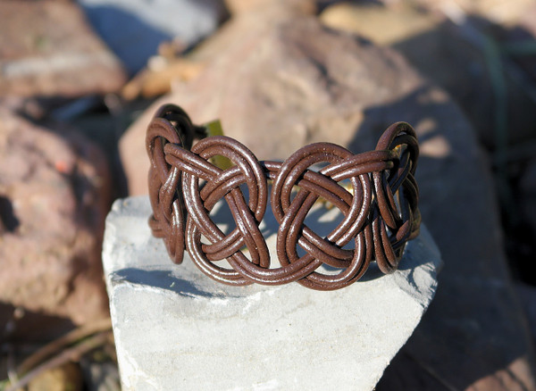 Double Coin knotted bracelet in Dark Chocolate Brown leather. Gold plated lobster clasp and jump rings create an adjustable size closure.