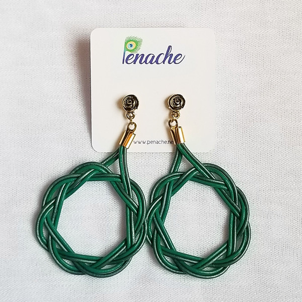 Dark Green & Green leather tied in Celtic Circle knot design. Titanium post for metal sensitive ears. Hangs 3 inches in length.