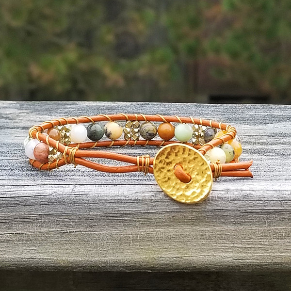 Tahiti leather with Golden Sage Amethyst & gold beads. Hammered Gold button closure.  Two button holes fits 6 1/4 in & 7 in wrist.