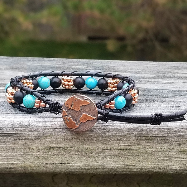 Black leather with Magnesite, Matte Onyx & Copper beads. Copper Earth button closure. Two button holes fits 6 1/4 inch & 7 inch wrist