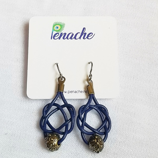 Dark Blue leather tied in Square knot design. Niobium fish hook post for metal sensitive ears. Hangs 2 inches in length.