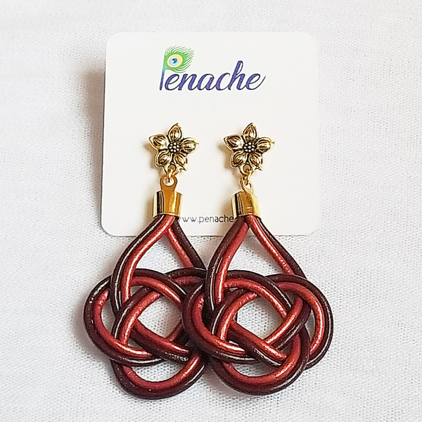 Maroon & Metallic Red leather tied in Double Coin Knot design. Titanium posts for metal sensitive ears. Hangs  2 1/2 inches in length.