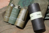 yellow red and green smoke grenades and original container