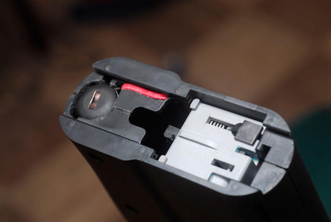 PS90 laser battery above trigger pack.