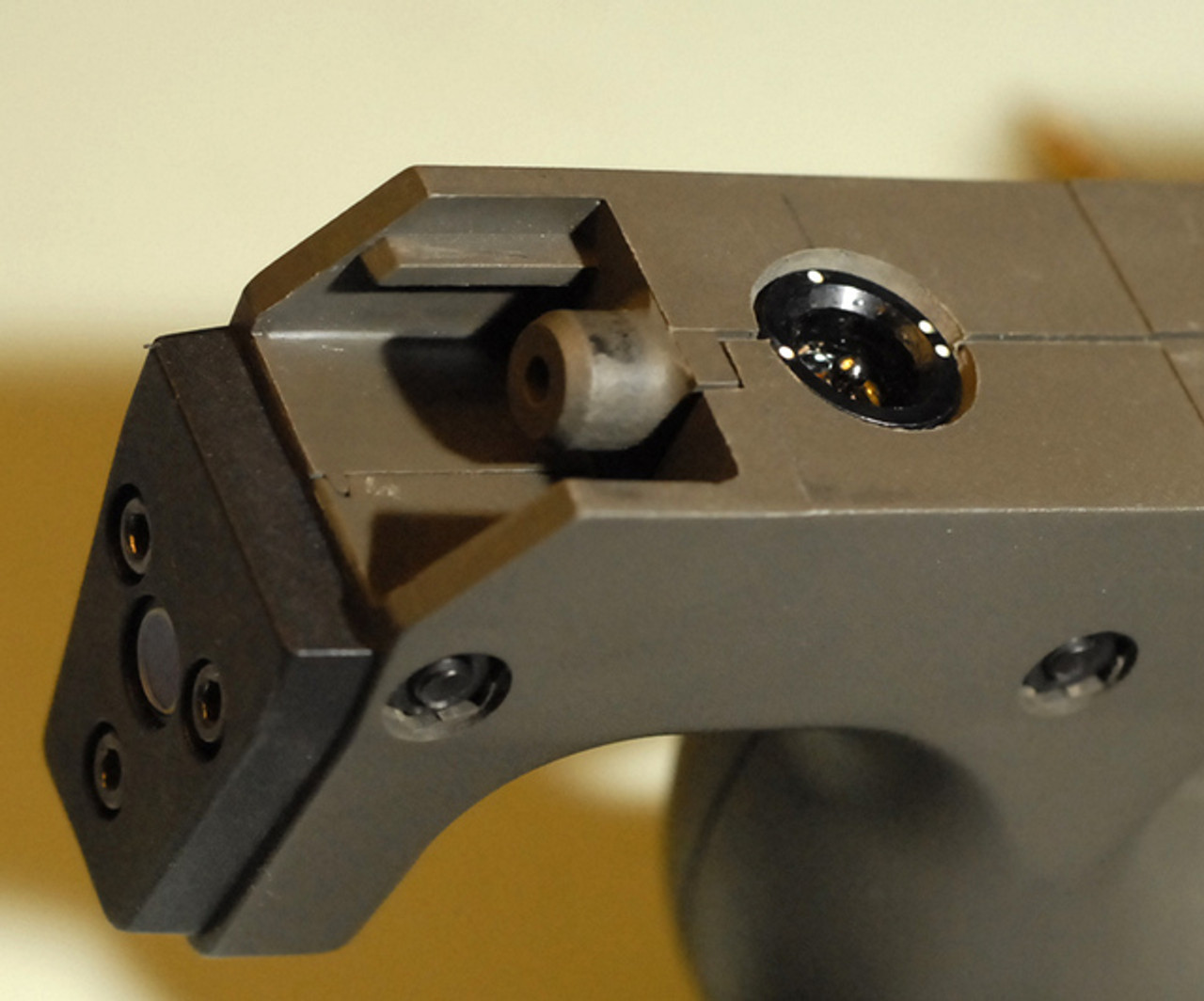 PS90 P90 internal laser details showing switch and housing.