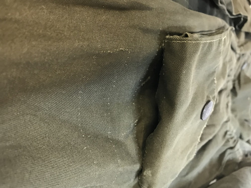 Stitching on top pocket, a little loose