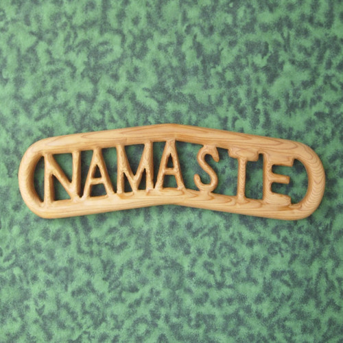 "Wood carved ""Namaste"" by Signs of Spirit."
