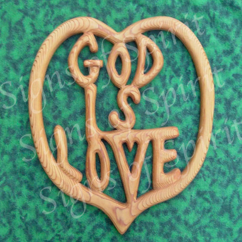 """God is Love"" wood carved wall hanging from Signs of Spirit."