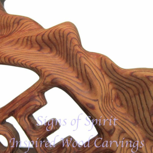"""Details of """"Be Here Now"""" wood carving by Signs of Spirit. Look at the grain...it is amazing!"""