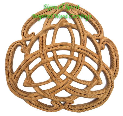 Celtic Peace Knot wood carving by Signs of Spirit. This is an example of when Katrina wood burns the separating line of the double strands.