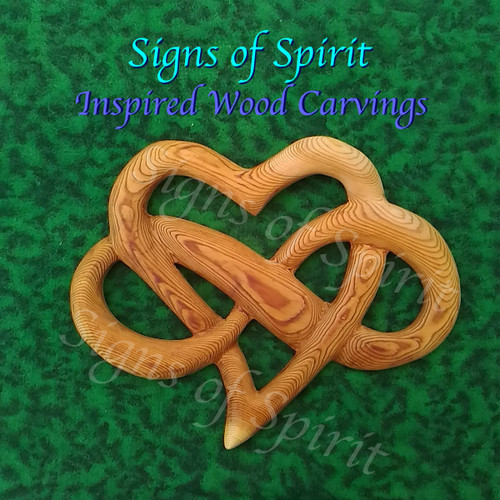 Heart of Infinite Love wood carving by Signs of Spirit.