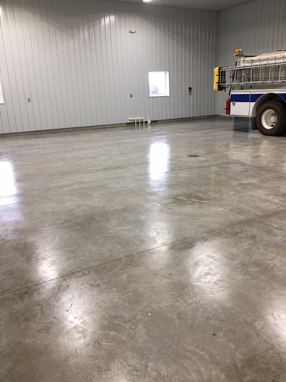 Brighton IL Fire Department Concrete Floor Sealed with Firehouse WP Concrete Sealer and topped with Awesome 21 Floor Finish.  By Chuck McBride of Chucks Cleaning Service