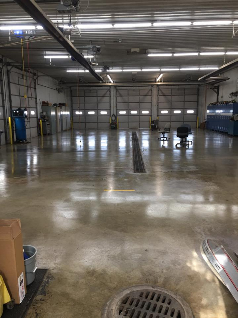 Another view of the Brighton IL Fire Department Concrete Floor Sealed with Firehouse WP Concrete Sealer and topped with Awesome 21 Floor Finish. By Chucks Cleaning Service.