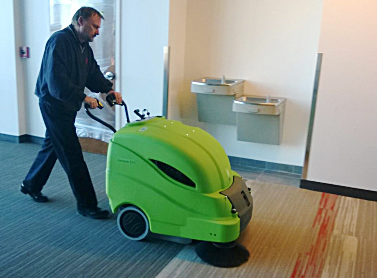 The 512 Vacuum Sweeper makes quick work of large traffic areas in offices.