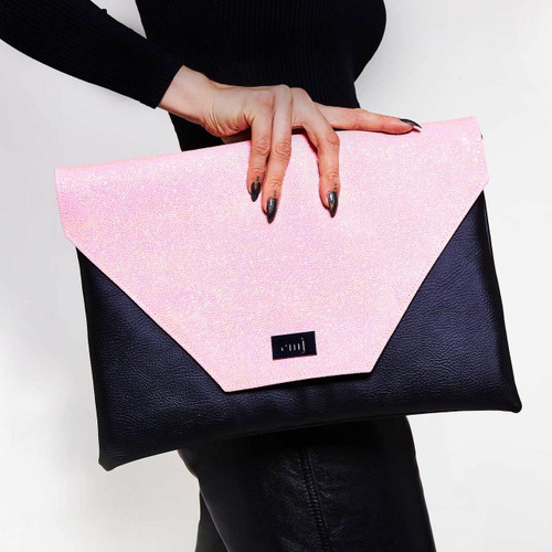Candy pink oversized clutch bag that doubles up as a laptop bag. Vegan and cruelty free