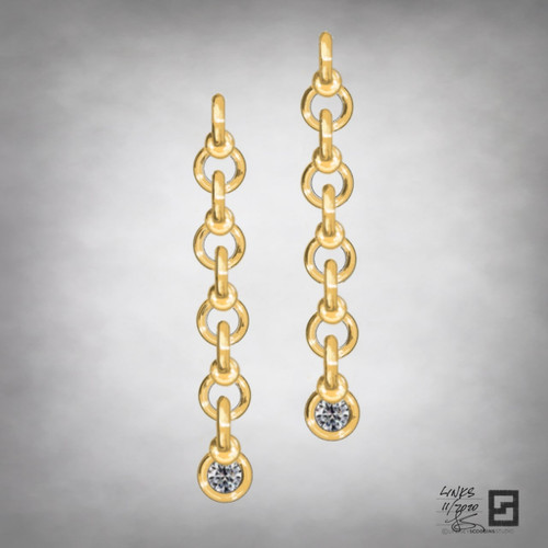 twisted infinity ball and chain link earrings in 18 karat gold with diamonds
