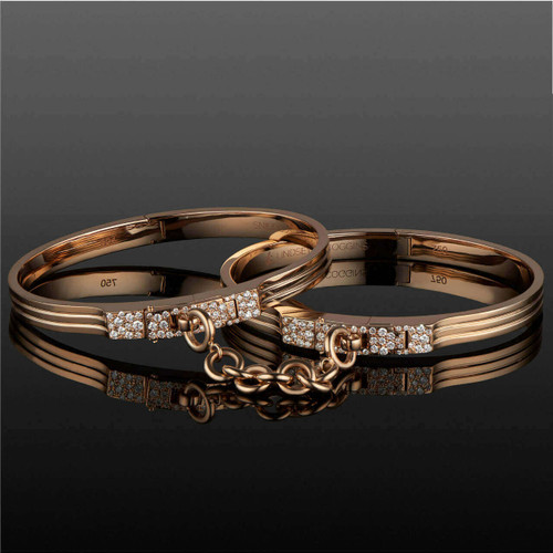 original triple secure handcuff bangles in 18 karat gold with pave diamond accent
