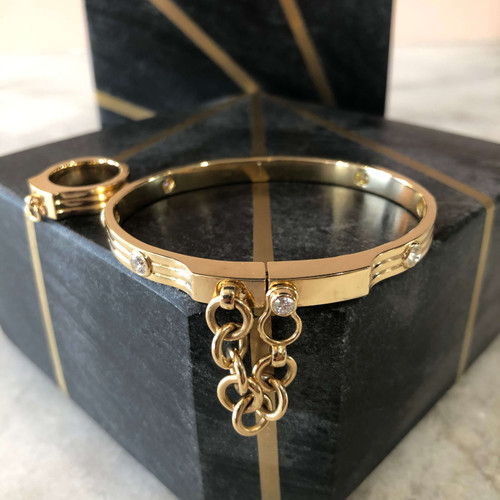 OATH bangle with hook closure and bezel set diamonds