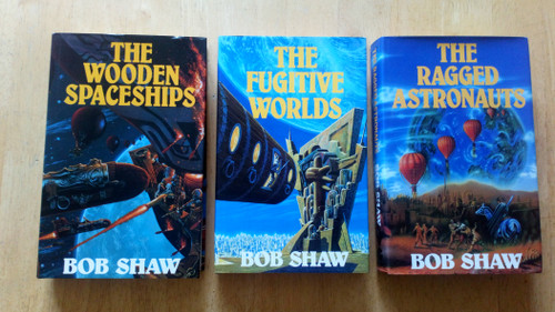 Shaw, Bob -  Land and Overland Trilogy -  ( The Wooden Spaceships, The Fugitive Worlds, The Ragged Astronauts ) - Complet Trilogy Hb 1st Editions Gollancz SF