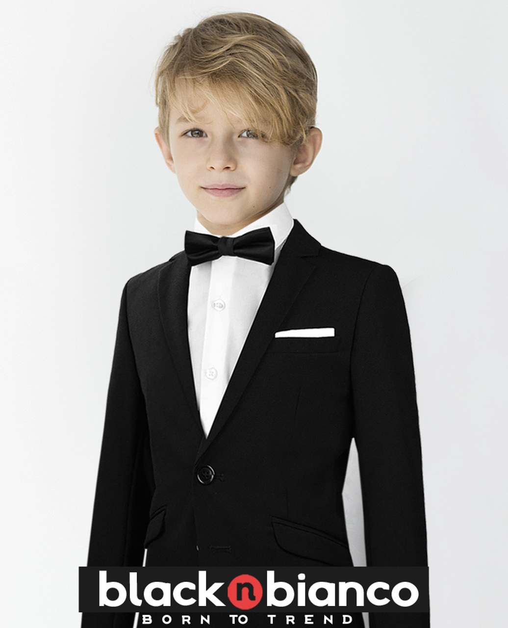 b9fb69e5cd5d Handsome Little Boy Sporting his Black N Bianco Signature Slim Tuxedo Suit  with a Slim Bow
