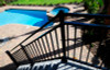 Westbury Riviera C30 Stair Railing on Outdoor Stairs Leading to Pool