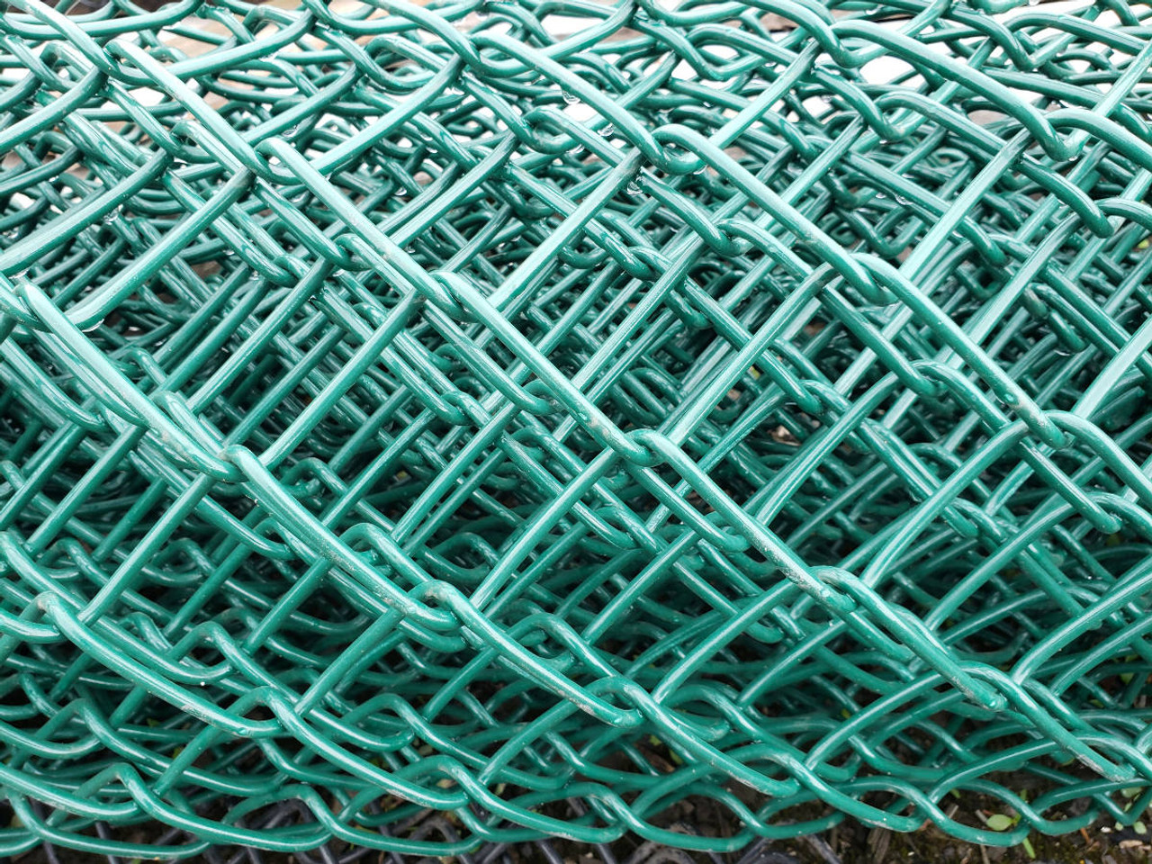 Closeup of 9ga Green Vinyl Coated Chain Link Fabric