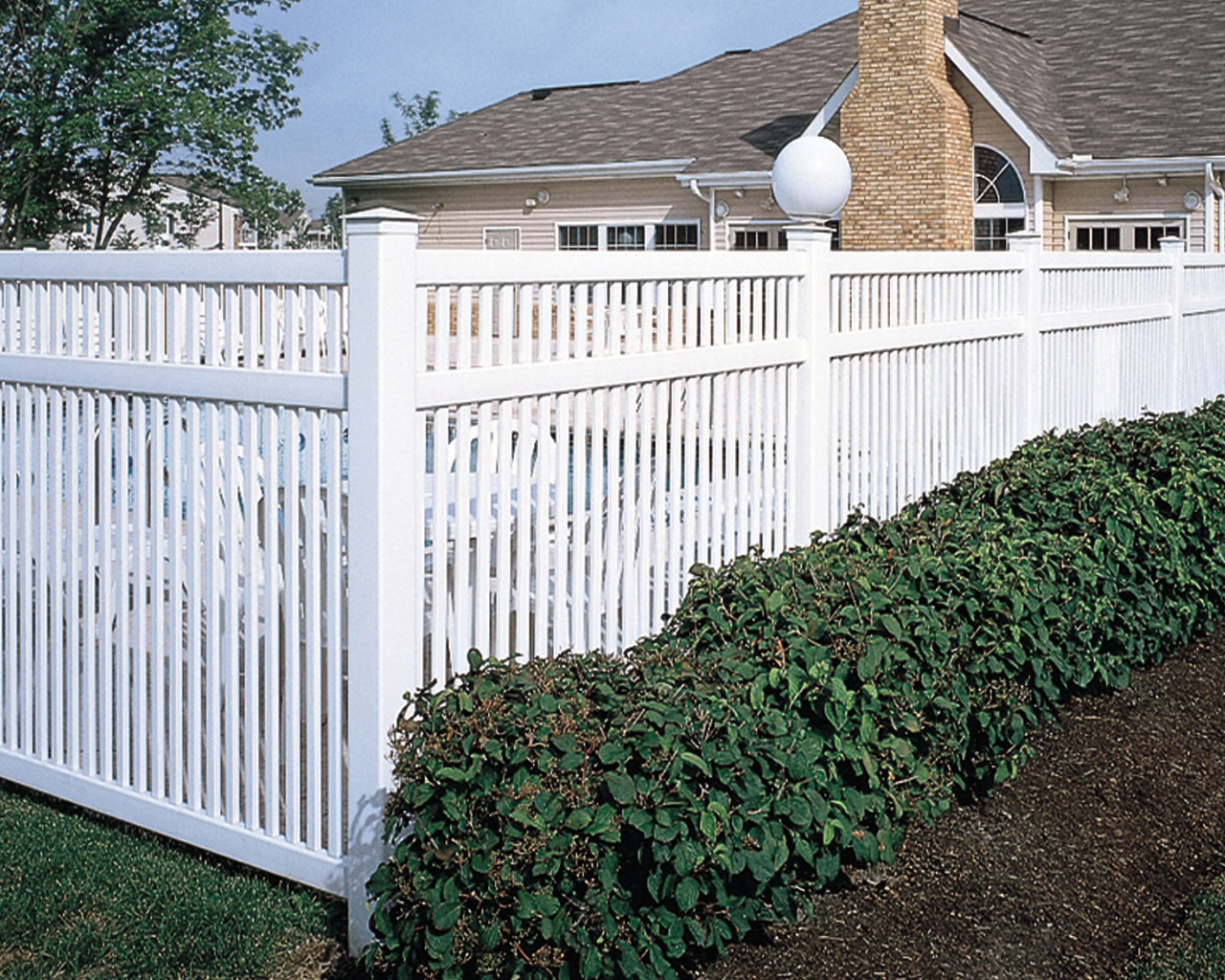 White Bufftech Princeton Vinyl Fence Around a Swimming Pool