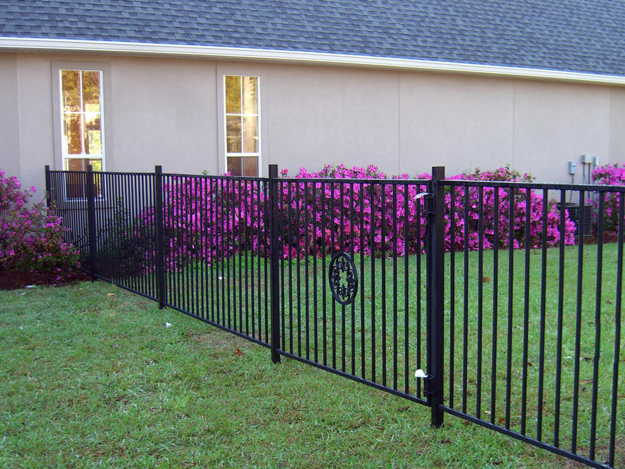 Ornamental Fence Posts Installed with the I2-850 OZ-Post Post Anchors