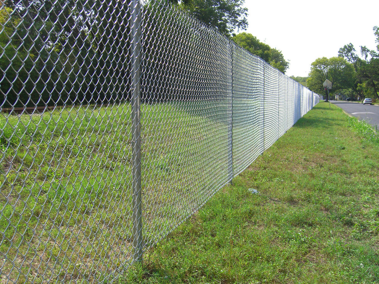 """Chain Link Fence Installed with OZ-Post HB-700 1-7/8"""" Post Anchors"""