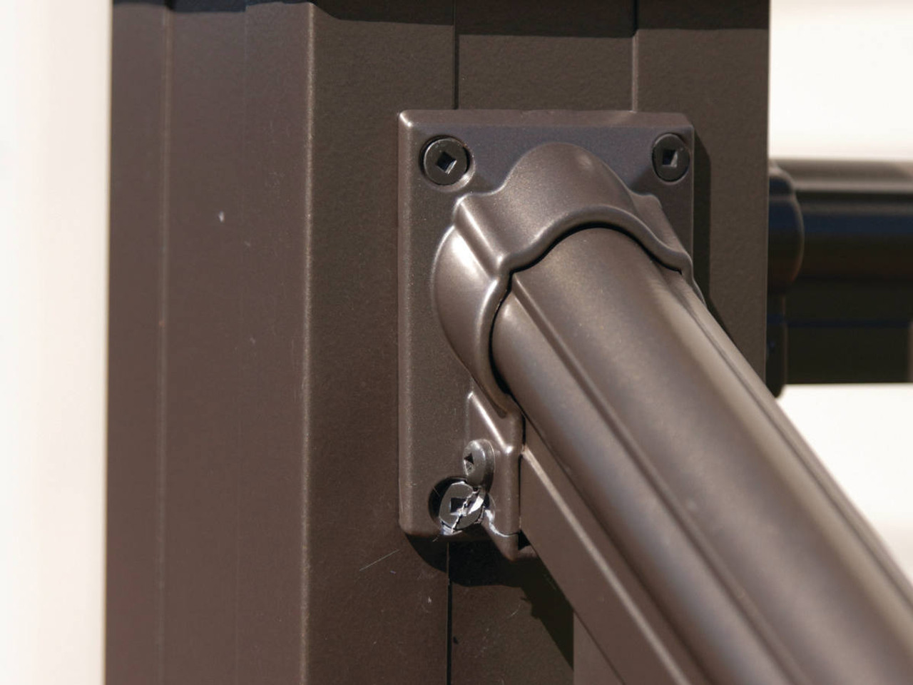 Closeup of Arabian Series Stair Rail with Mounting Bracket - Gloss Bronze