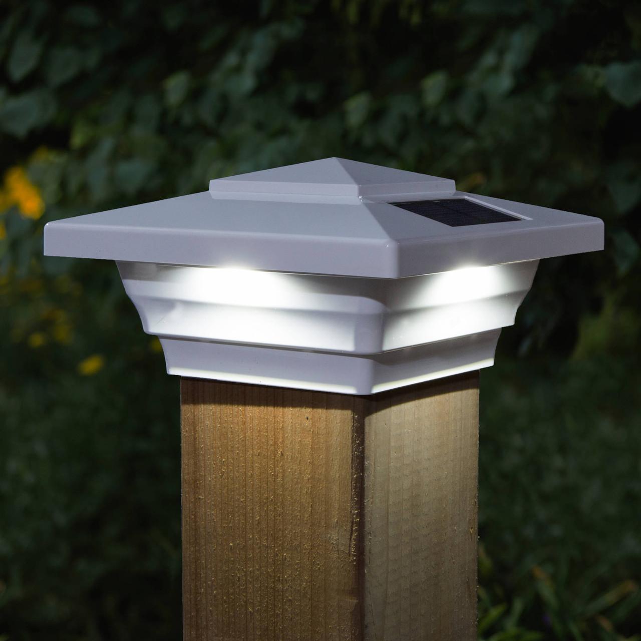Windsor White Solar Post Cap Light on Wood Post At Night