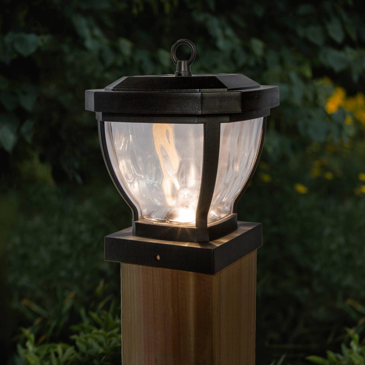 Classy Caps Manchester 4x4 Dark Bronze Solar Post Cap on Wood Post Illuminated at Night
