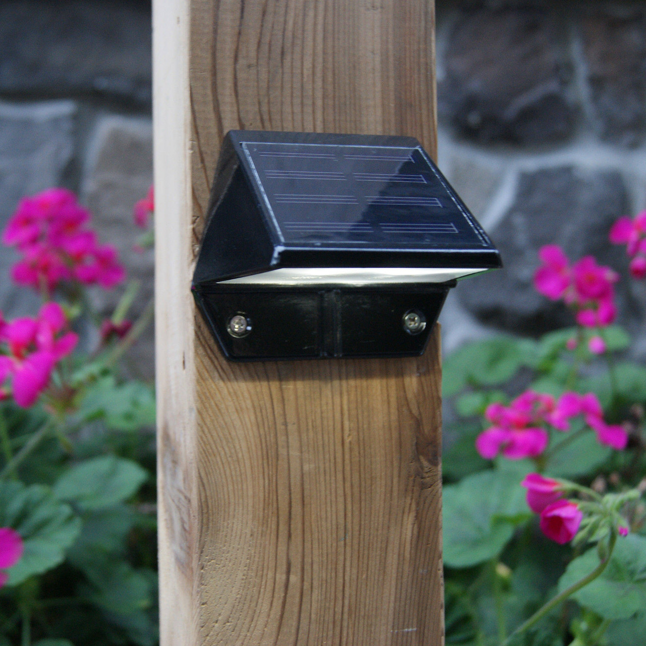 Black Solar Deck & Wall Light (SL178) from Classy Caps on Wood Post
