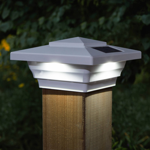 Windsor White Solar Post Cap Light on Wood Post At Night