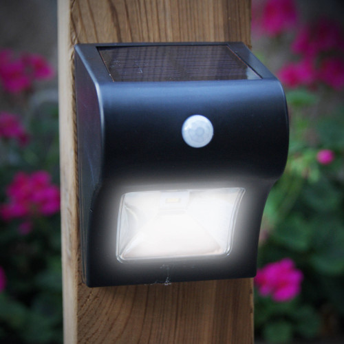 Black Solar Motion Sensor Deck & Wall Light from Classy Caps on a Wood Post