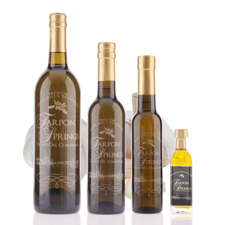 Four different size bottles of Tarpon Springs Garlic Infused Olive Oil