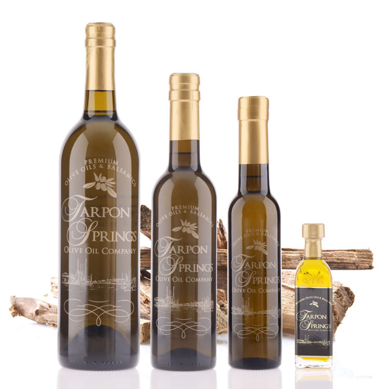 Four different size bottles of Tarpon Springs Olive Wood Smoked Infused Olive Oil