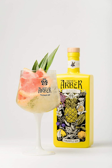 Agnes Arber Pineapple Gin, 70CL. Served in a gin balloon glass