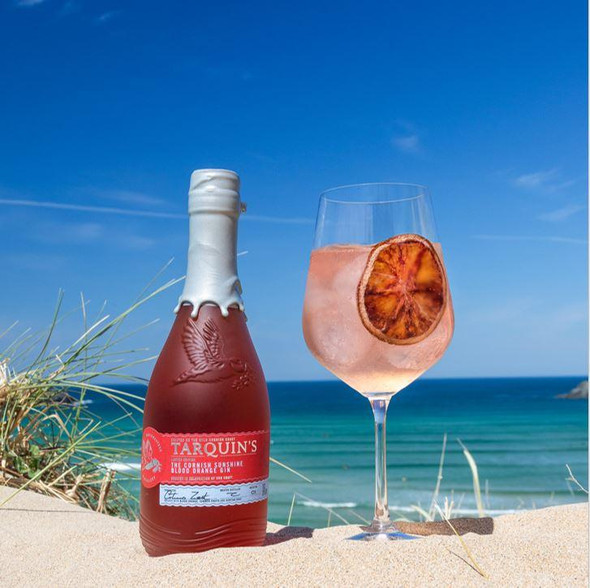 TARQUIN'S CORNISH SUNSHINE BLOOD ORANGE GIN, 70cl mixed with sparkling elderflower presse and garnished with a large citrus wheel