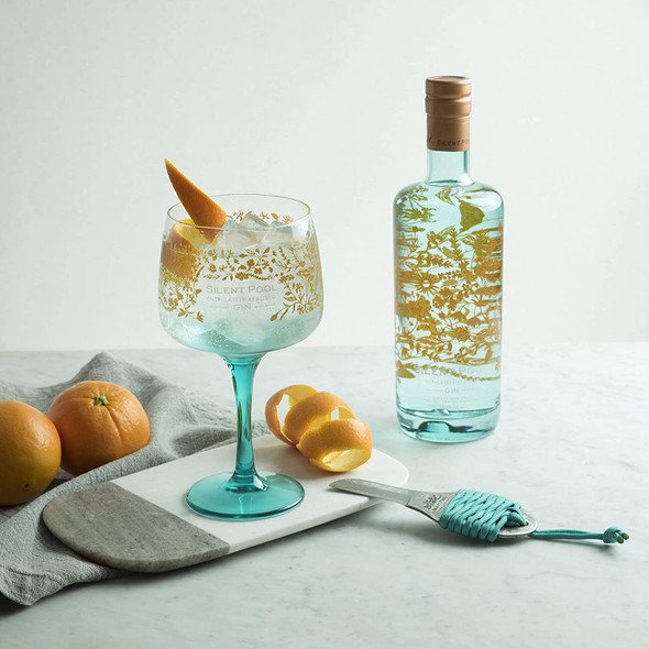 Silent Pool Gin, 70cl served in gin glass with orange zest