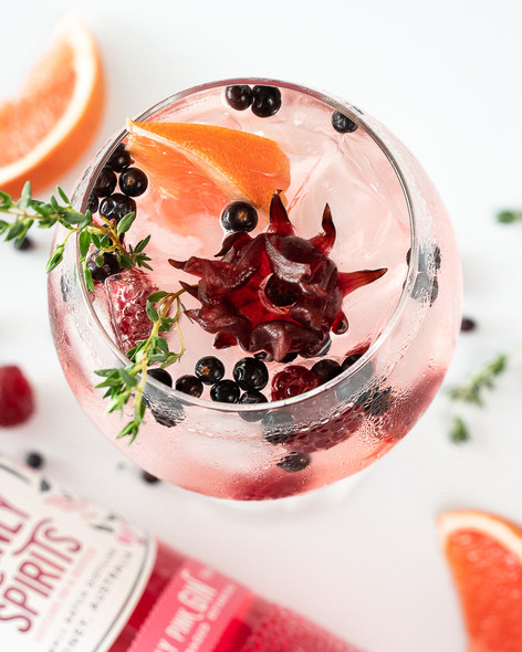 Manly Spirits Co. Lilly Pilly Pink Gin served in cocktail glass with botanicals