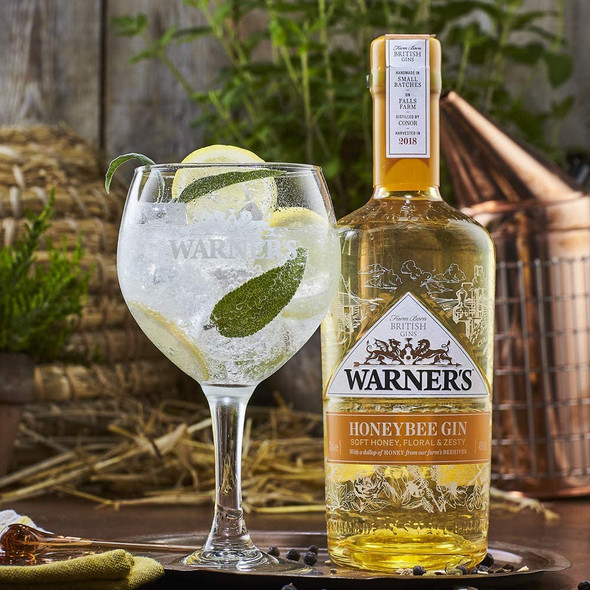 Warner's Honey Bee Gin, 70cl served in a balloon gin glass
