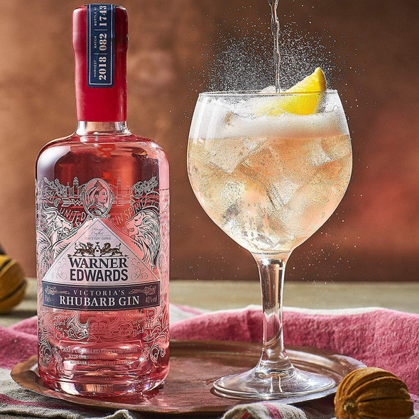 Warner's Rhubarb Gin, 70cl served in gin glass with tonic water being poured