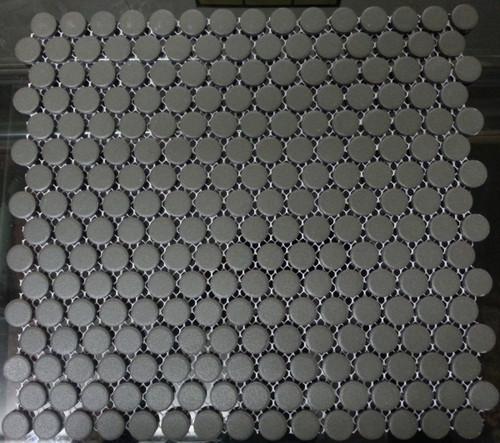 Unglazed black penny round mosaic tiles