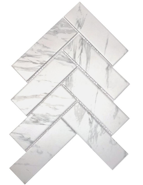Carrara look porcelain mosaic tiles. Herringbone.