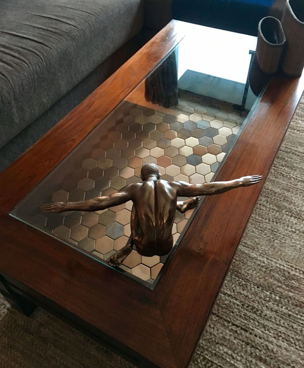 Copper hexagon tiles under glass coffee table.