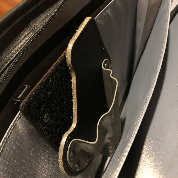 Holster and platform in a briefcase