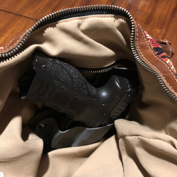 Holster and platform in a purse