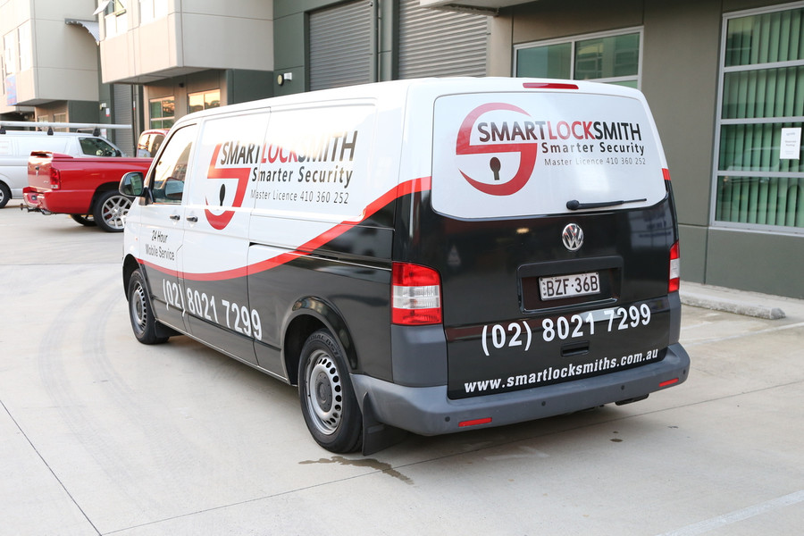 Smart Locksmith Van with Reflective Numbers
